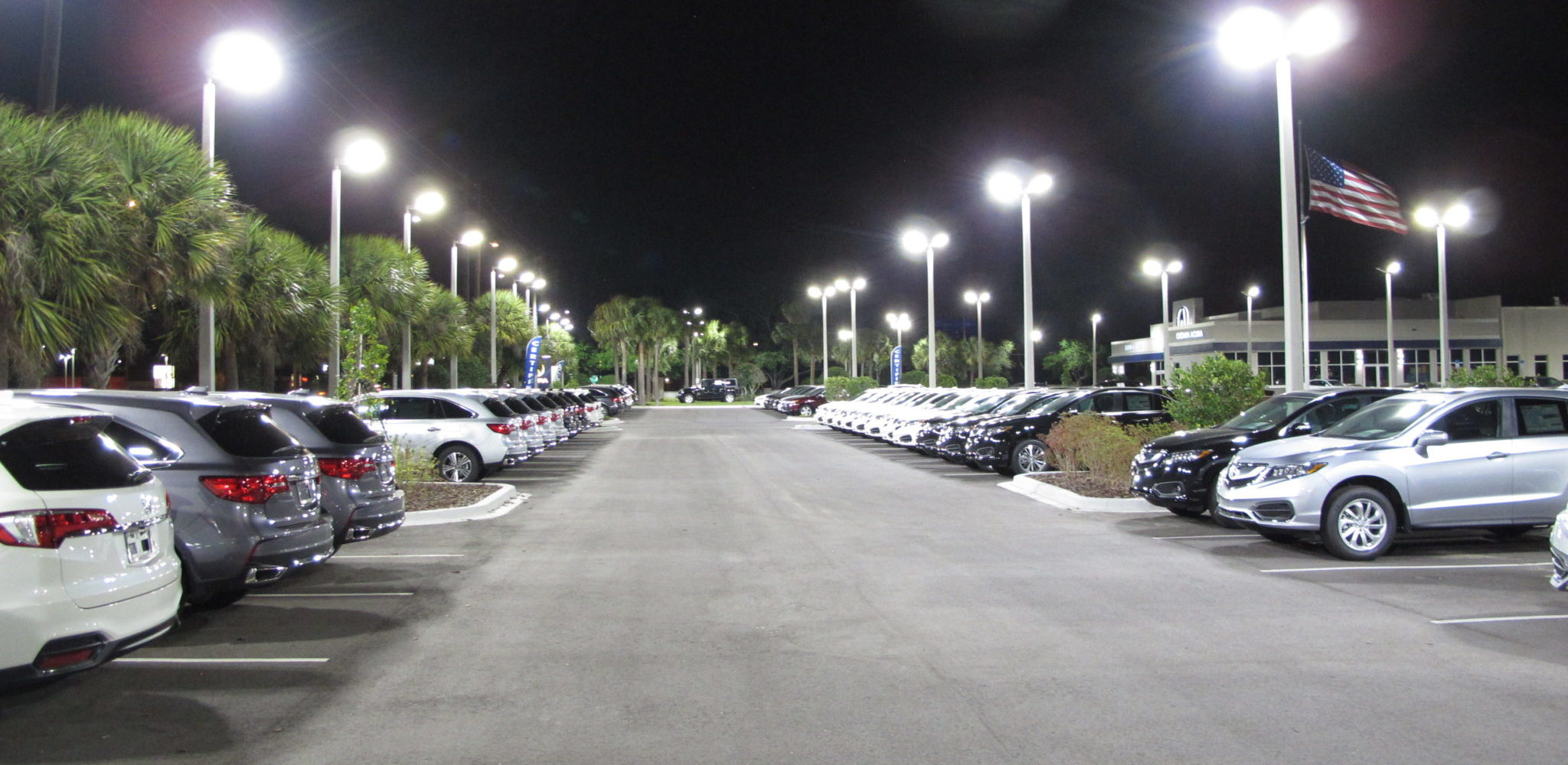 LED Lighting at Crown Acura Car Dealership in Clearwater, Florida. Car Dealership LED Lighting. LED Lighting Pinellas County. parking lot lighting for car dealership in Clearwater. Crown Acura Car Dealership in the Tampa Bay area in Florida where Arkon Power provided LED site lighting, photometric design, and Light poles.  Arkon worked with engineers to design the lighting layout at this Clearwater based and ensure it would meet all foot candle requirements.